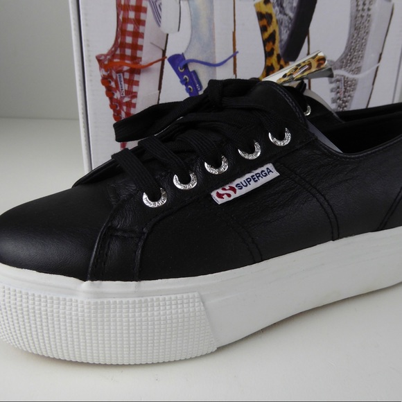 PUMA | black leather platform sneakers NWT